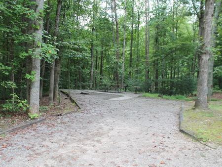 Gravel site with table, fire pit, grill