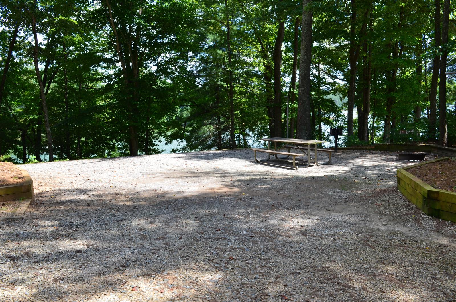 Gravel site with fire pit, table, grillGravel site with fire pit, table, grill, views of water