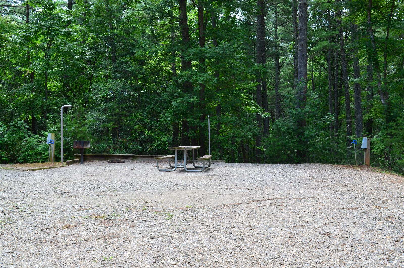 Gravel site with table, fire pit, grill Shared site with 23 to the left with table, grill, fire pit