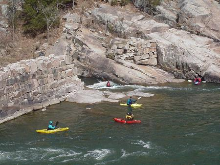Kayakers by old mining company dam on St. Francis river
