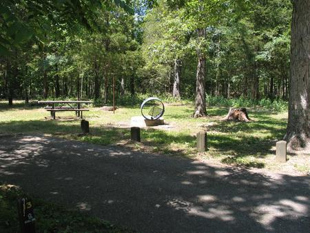 Campsite 13 showing parking spur, picnic table, lantern post and fire ringCampsite 13