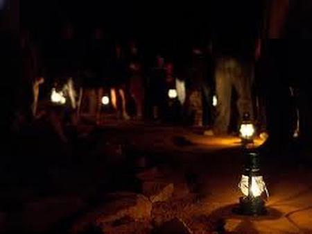 Visitors carrying lanterns on the Violet City Lantern Tour.
