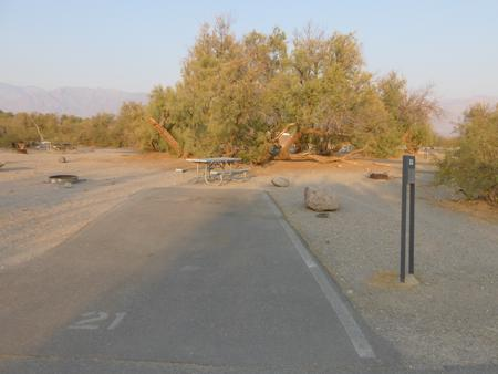 Furnace Creek Campground standard nonelectric site #21 with picnic table and fire ring.