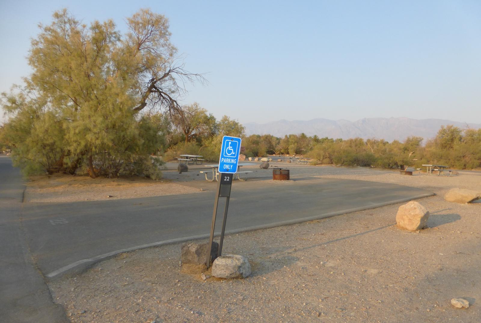 Furnace Creek Campground standard nonelectric ADA site #22 with accessible picnic table and fire ring.