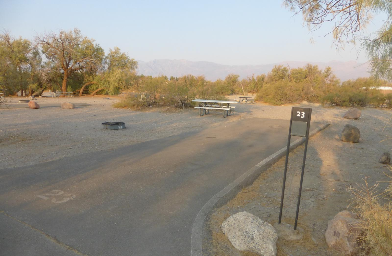 Furnace Creek Campground standard nonelectric site #23 with picnic table and fire ring.