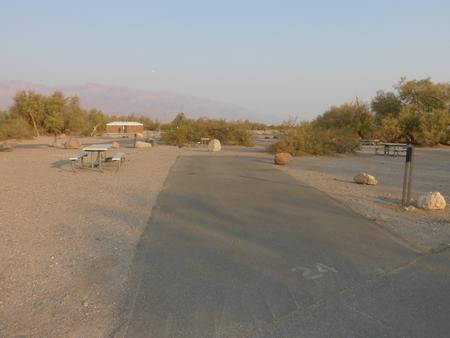 Furnace Creek Campground standard nonelectric site #24 with picnic table and fire ring.