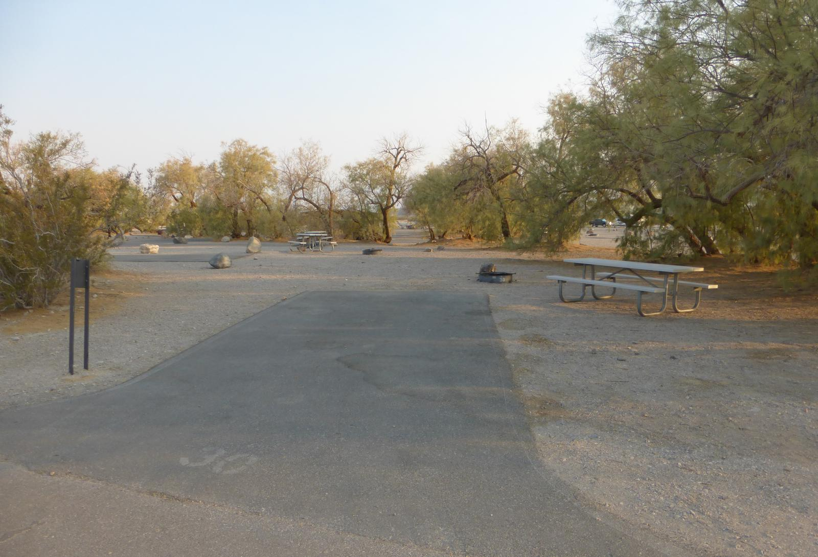 Furnace Creek Campground standard nonelectric site #30 with picnic table and fire ring.
