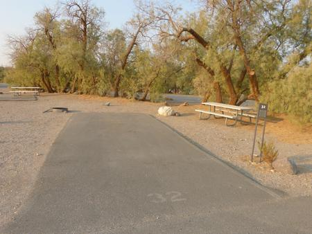 Furnace Creek Campground standard nonelectric site #32 with picnic table and fire ring.