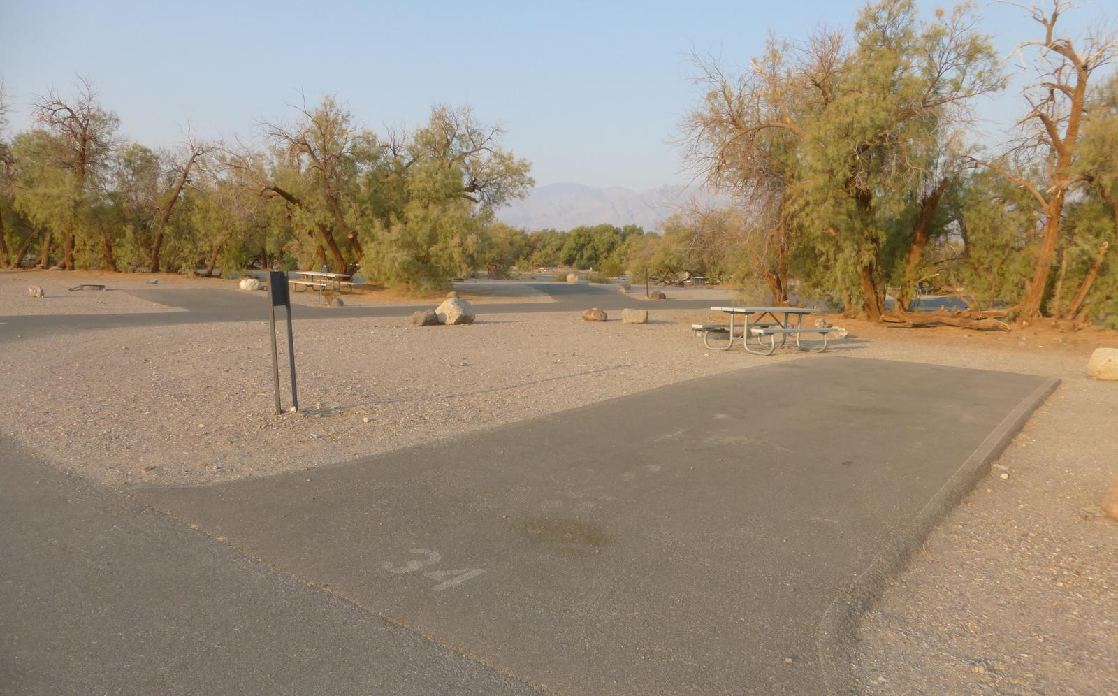 Furnace Creek Campground standard nonelectric site #34 with picnic table and fire ring.