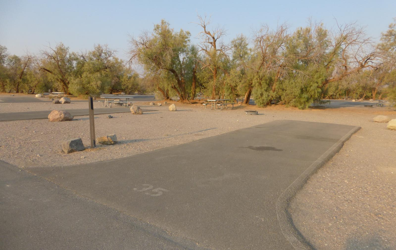 Furnace Creek Campground standard nonelectric site #35 with picnic table and fire ring.