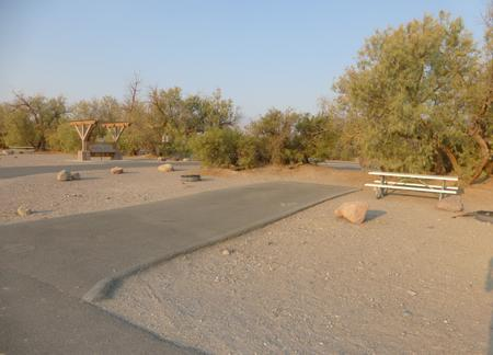 Furnace Creek Campground standard nonelectric site #40 with picnic table and fire ring.