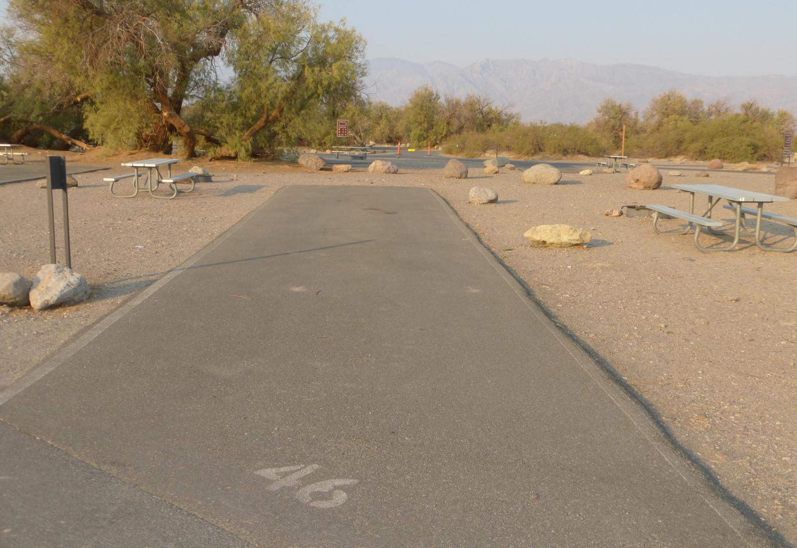 Furnace Creek Campground standard nonelectric site #46 with picnic table and fire ring.