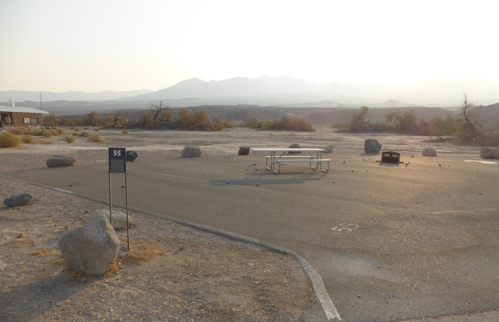 Furnace Creek Campground standard nonelectric site #55 with picnic table and shared fire ring with site #54.