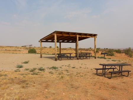 Lone Mesa Group Site A shade shelter and picnic tables.