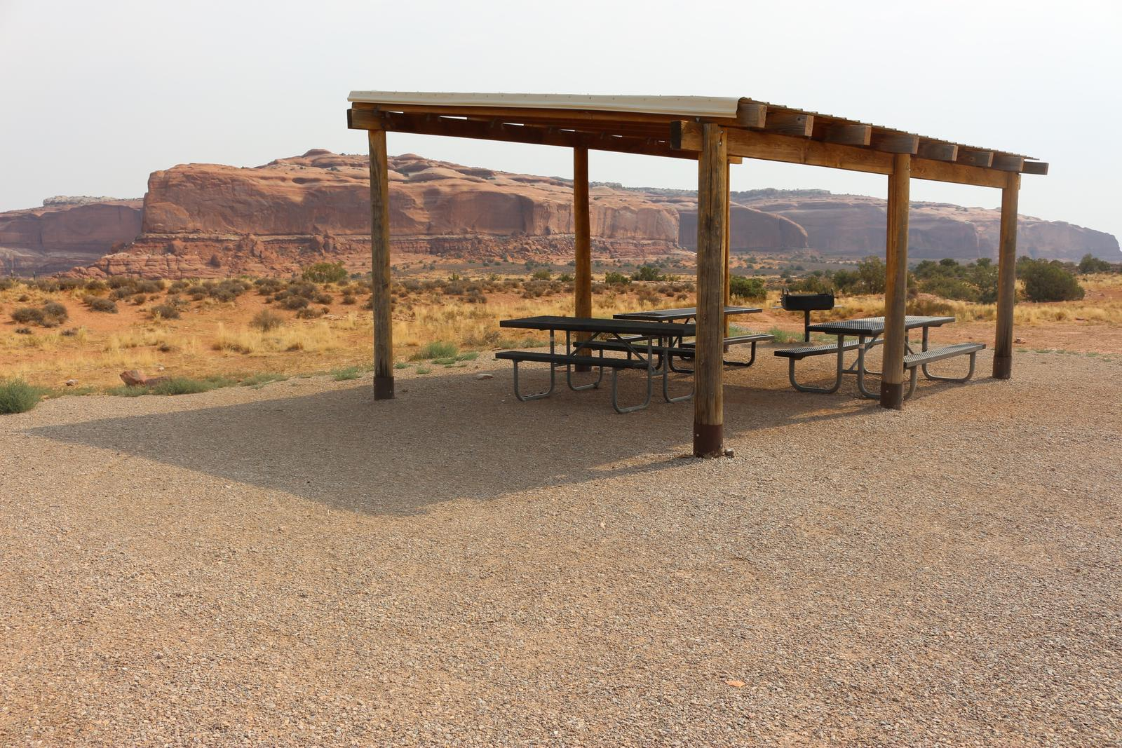 Close up of the Lone Mesa Group Site B shade shelter and picnic tables.