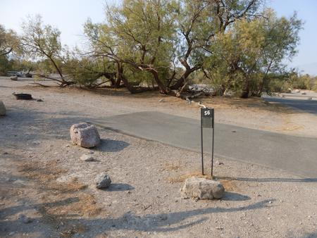 Furnace Creek Campground standard nonelectric site #56 with picnic table and fire ring.
