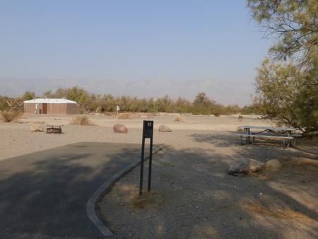 Furnace Creek Campground standard nonelectric site #59 with picnic table and fire ring.