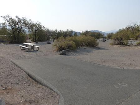Furnace Creek Campground standard nonelectric site #60 with picnic table and fire ring.