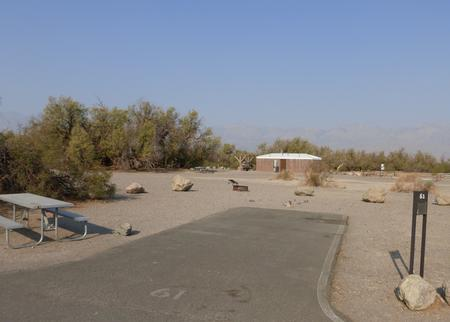 Furnace Creek Campground standard nonelectric site #61 with picnic table and fire ring.