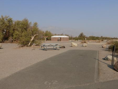 Furnace Creek Campground standard nonelectric site #62 with picnic table and fire ring.