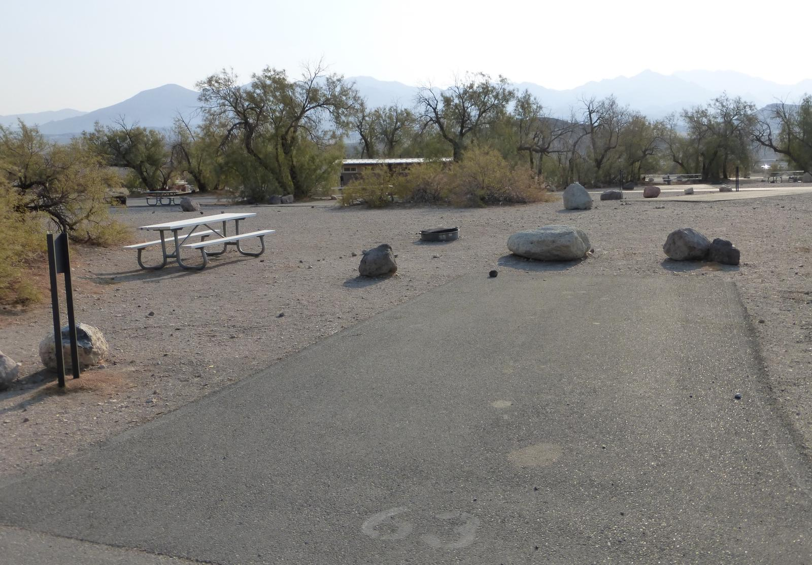 Furnace Creek Campground standard nonelectric site #63 with picnic table and fire ring.