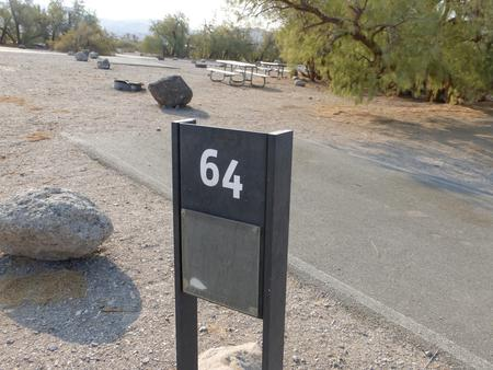 Furnace Creek Campground standard nonelectric site #64 with picnic table and fire ring.