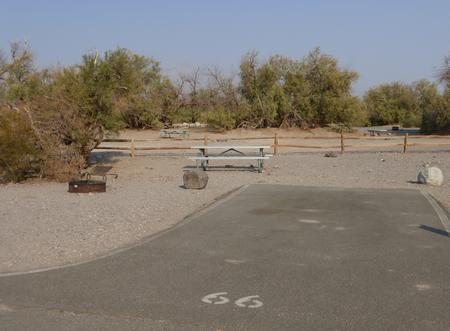 Furnace Creek Campground standard nonelectric site #66 with picnic table and fire ring.