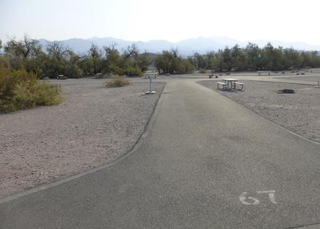 Furnace Creek Campground full hookup site #67. Water, sewer, and 30/50 amp electric connection. One fire pit and one picnic table.