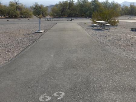 Furnace Creek Campground full hookup site #69. Water, sewer, and 30/50 amp electric connection. One fire pit and one picnic table.