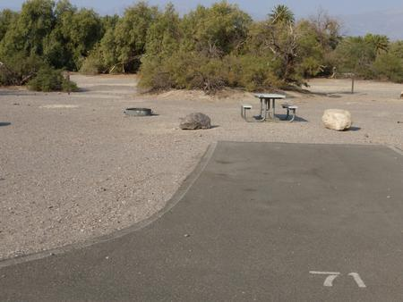 Furnace Creek Campground standard nonelectric site #71 with picnic table and fire ring.