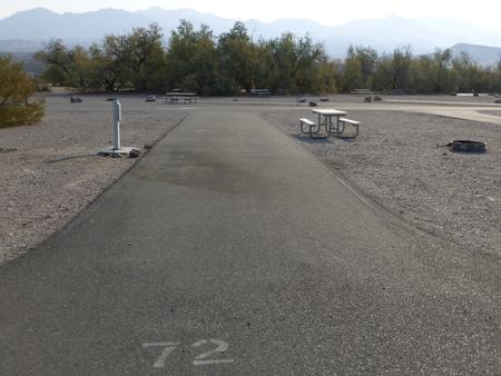 Furnace Creek Campground full hookup site #72. Water, sewer, and 30/50 amp electric connection. One fire pit and one picnic table.