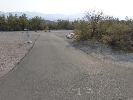 Furnace Creek Campground full hookup site #73. Water, sewer, and 30/50 amp electric connection. One fire pit and one picnic table.