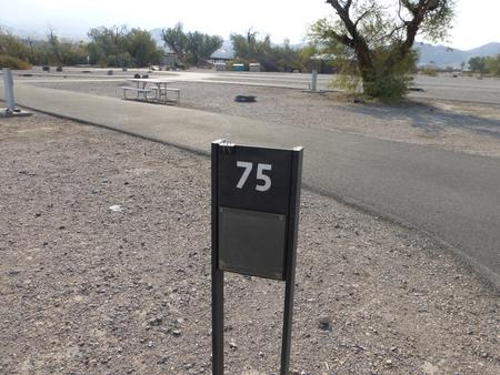 Furnace Creek Campground full hookup site #75. Water, sewer, and 30/50 amp electric connection. One fire pit and one picnic table.