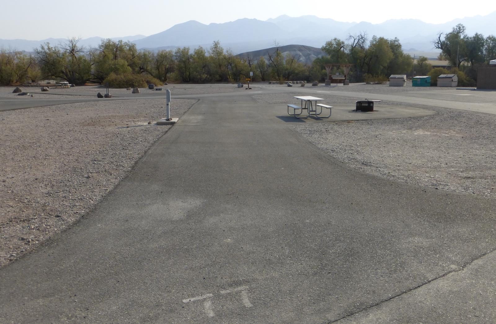 Furnace Creek Campground ADA full hookup site #77. Water, sewer, and 30/50 amp electric connection. One ADA accessible fire pit and picnic table.