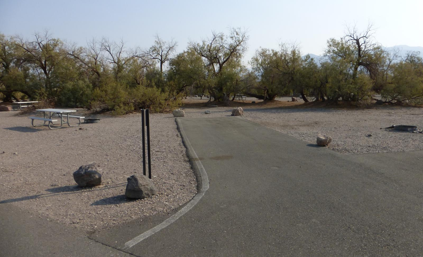 Furnace Creek Campground standard nonelectric site #80 with picnic table and fire ring.