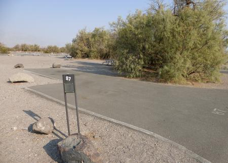 Furnace Creek Campground standard nonelectric site #87 with picnic table and fire ring.