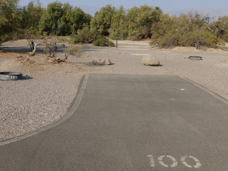 Furnace Creek Campground standard nonelectric tent only drive in site #100 with picnic table and fire ring.