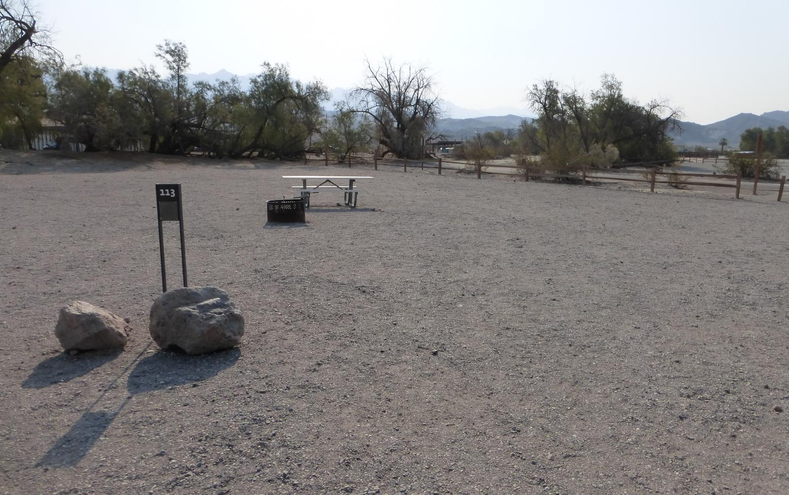 Furnace Creek Campground standard nonelectric site #113 with picnic table and fire ring.