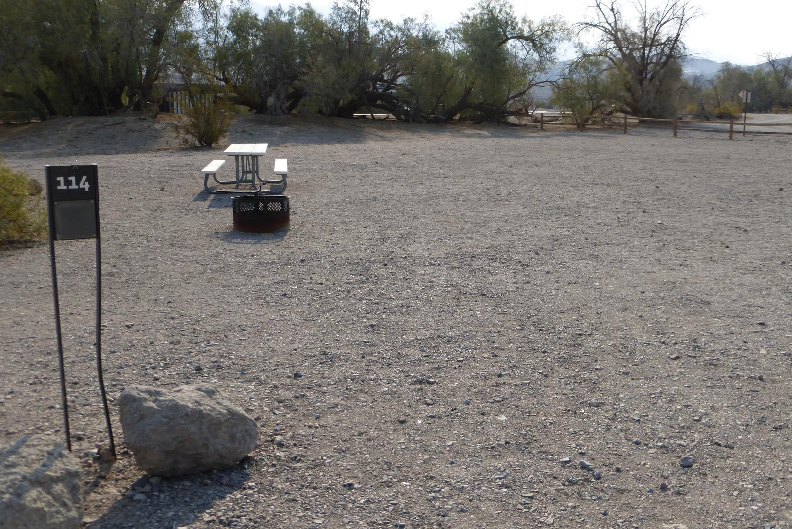 Furnace Creek Campground standard nonelectric site #114 with picnic table and fire ring.