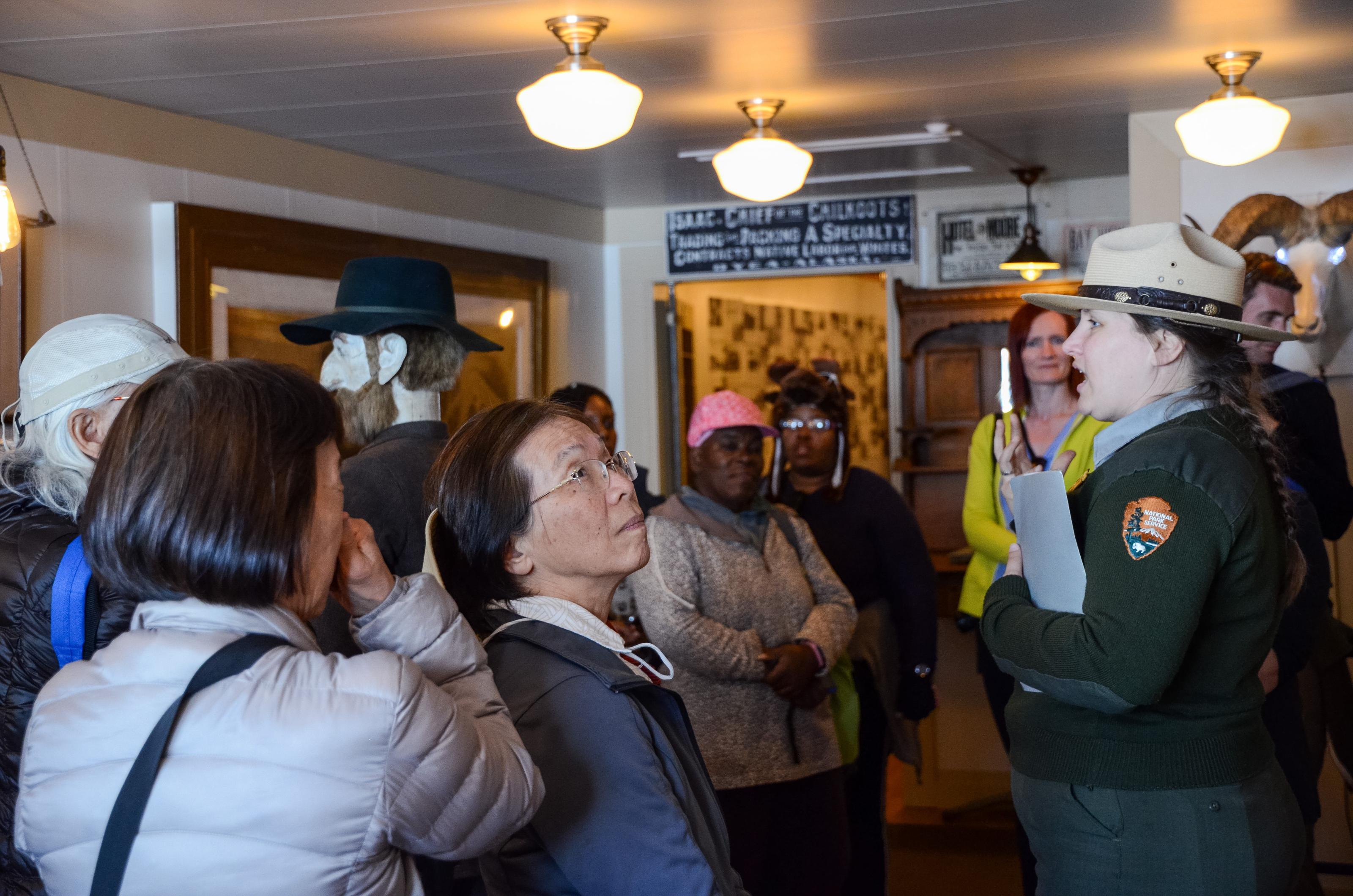 A visitor looks at the wall of the museum while a ranger talks to the tour group.Venture inside one of the weirdest museums in the National Park Service on a ranger-led tour.