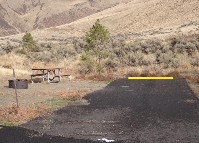 Fire ring, picnic table and parking pad at Big Pines campsite 34.Big Pines Campsite 34