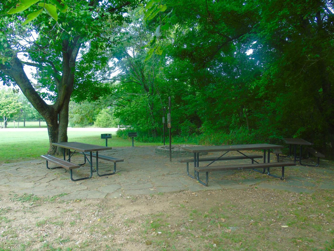 Tyler Bend Group Site 1-2Three picnic tables; two lantern holders;  two charcoal cooking stands; one large fire pit.