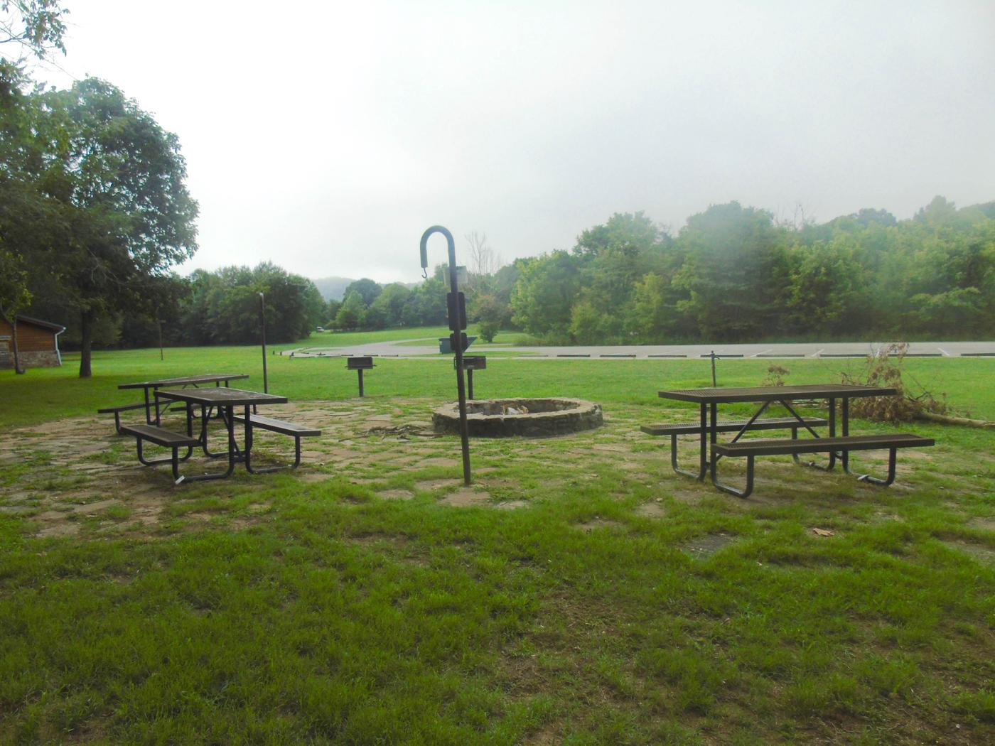 Tyler Bend Group Site 3-1Three picnic tables; two lantern holders; two charcoal cooking stands; one large fire pit.