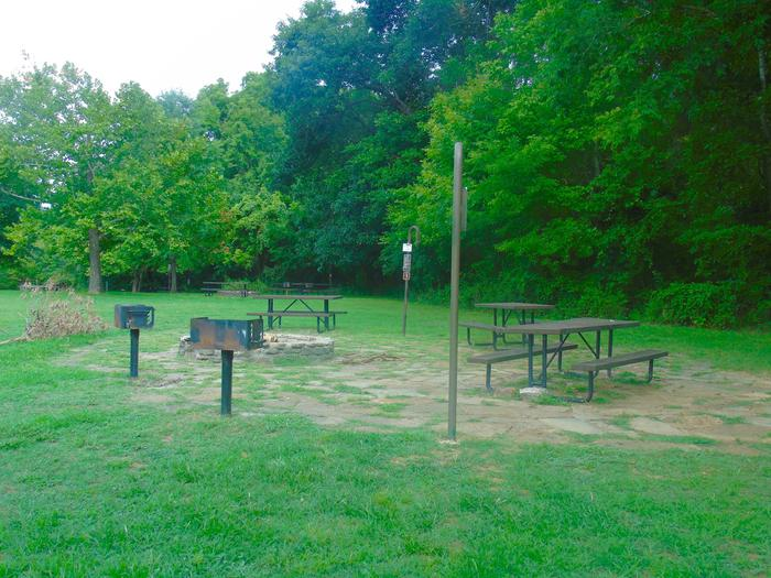 Tyler Bend Group Site 3-6Three picnic tables; two lantern holders; two charcoal cooking stands; one large fire pit.