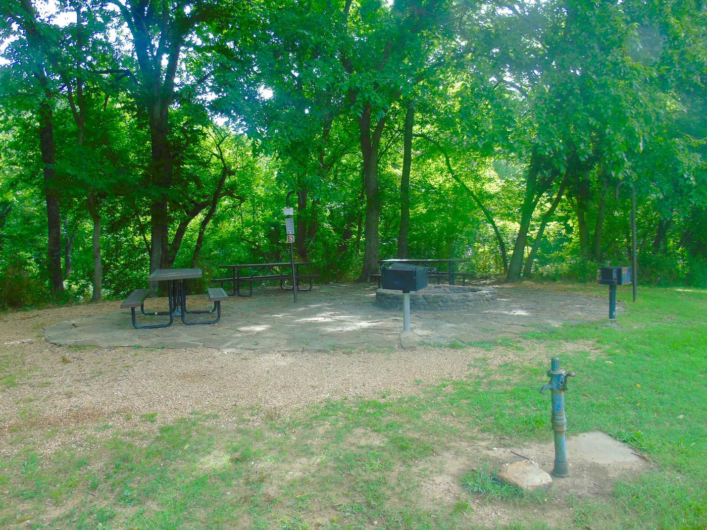 Tyler Bend Group Site 5Group Site #5, Three picnic tables; two lantern holders; two charcoal cooking stands; one large fire pit.