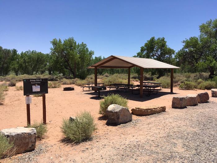 A photo of Group Site B picnic tables and shade structure.Picnic Tables and shade structure