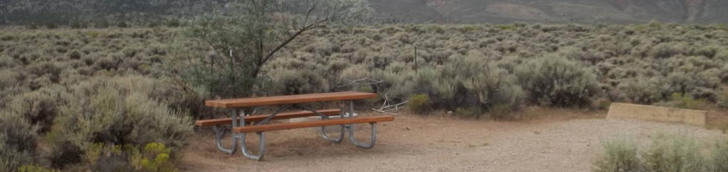 Picnic table off to the side of a RV parking locationAntelope Flat Campground: Site 12