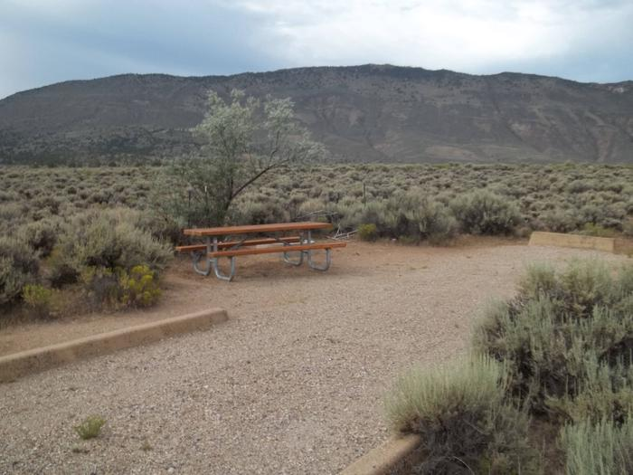 Picnic table off to the side of a RV parking location.Antelope Flat Campground: Site 12