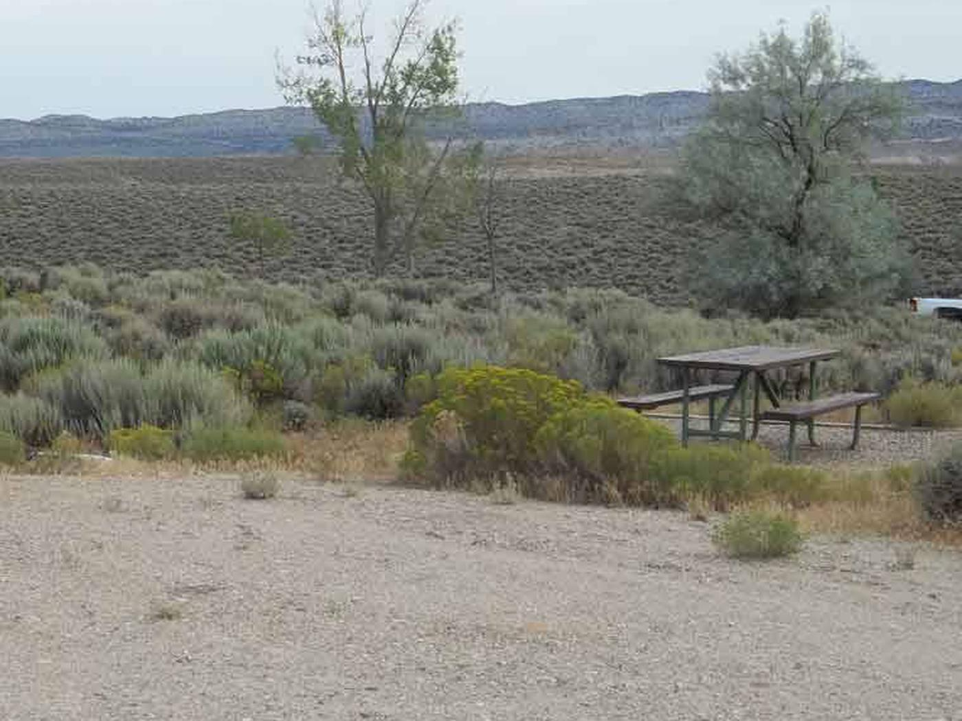 Picnic table that is located on the side a RV parking slot. Antelope Flat Campground: Site 13