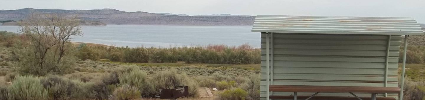 Partial covered picnic table with a lake in the background.Antelope Flat Campground: Site 29